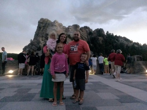 The Taylors Standing at Mt. Rushmore